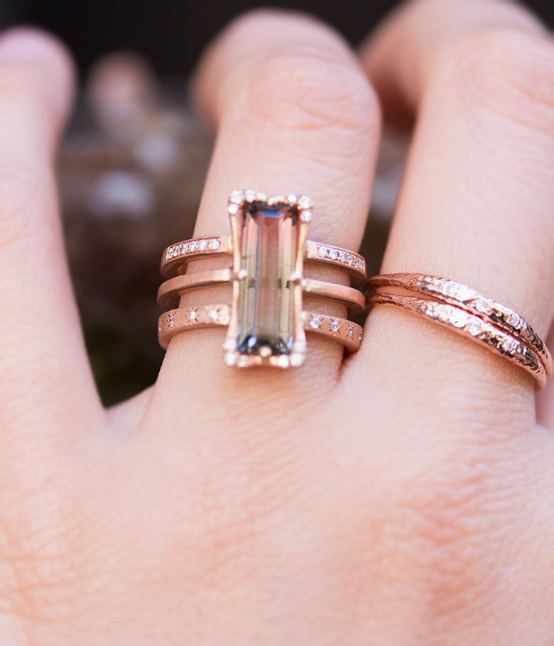 Wow wow wow! A stunning 2.55 watermelon tourmaline is set into 14K rose gold atop a three layered band and sprinkled with .15carats diamonds Please allow approximately three weeks for a similar ring t