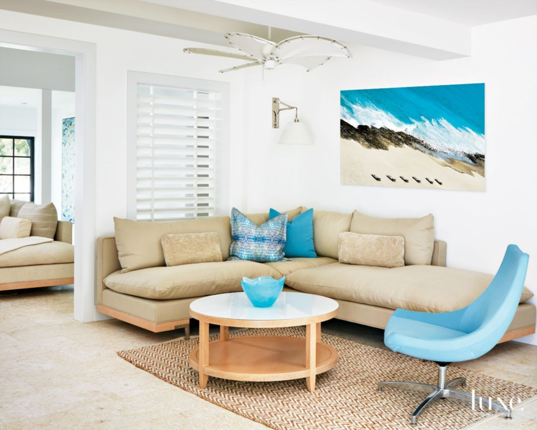 Living room furnishings include a chaise that Erin Paige Pitts ...