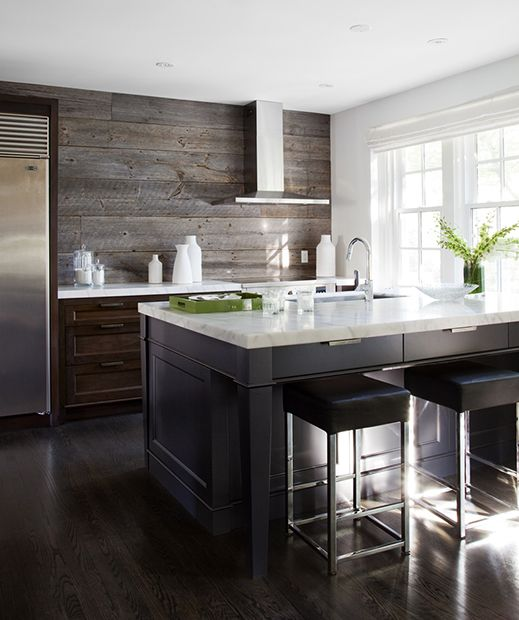 Lovely kitchen features dark stained cabinets paired with white