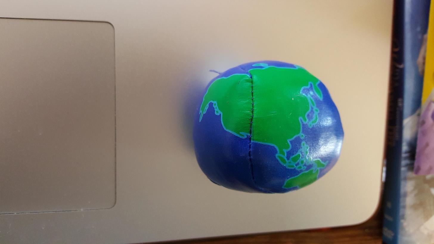This juggling ball globe has its hemispheres mixed up