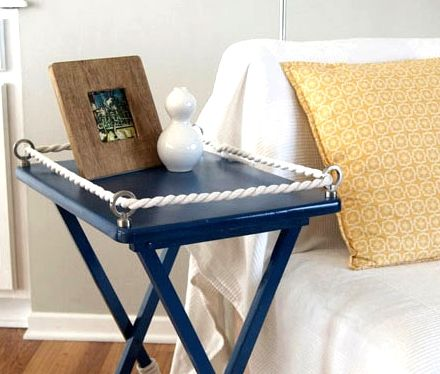 40 Nautical Crafts for the Home. Add hoops to corners of table top on plain old folding table.  Add rope for nautical decor.