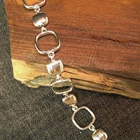 """'Soft Squares' Link Bracelet  Measuring approximately 7.5"""", this sterling bracelet is sturdy and fashionable, yet goes with anything! Perfect for everyday wear. Matching earrings are also available."""