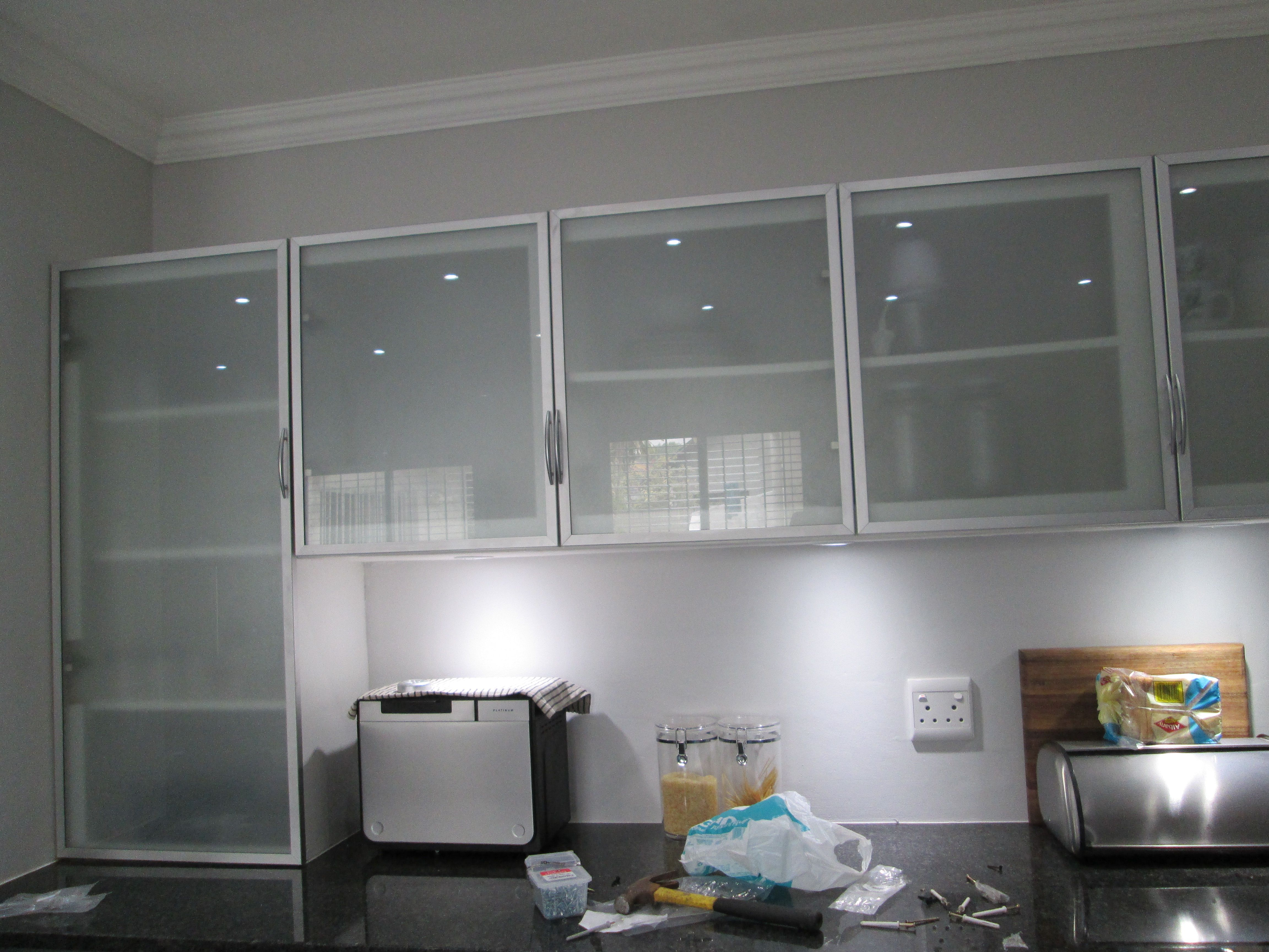 This kitchen is incorporating aluminium frame cabinet doors with frosted glass inserts Kitchen profile glass design