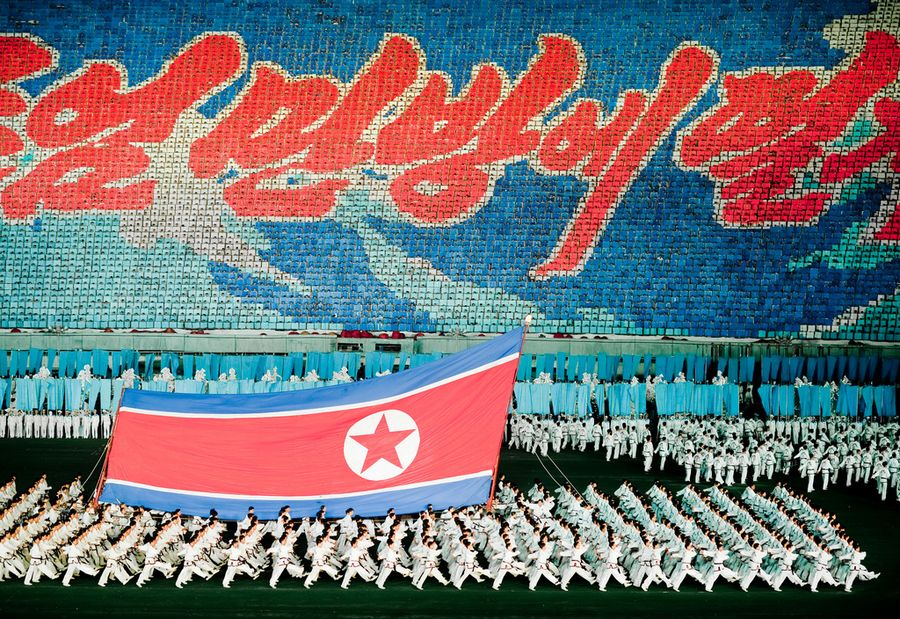 Mass Games Pyongyang (North Korea). 'Schoolchildren swing tennis racquets, twirl hula hoops or rush around in rubber rings, miming a fun family day on the North Korean beach. They'll soon be followed by the incredible North Korean dancing army, conclusively proving that if wars were decided on the dance floor they could annihilate any foe. It's the Pyongyang Mass Games, the number one attraction for foreign visitors to the reclusive capital.' http://www.lonelyplanet.com/north-korea/pyongyang