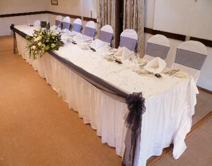 Decorating Round Tables At A Wedding Navy Top Table Swags With White Chair Covers Na Chair Covers Wedding Wedding Decorations 50th Anniversary Decorations