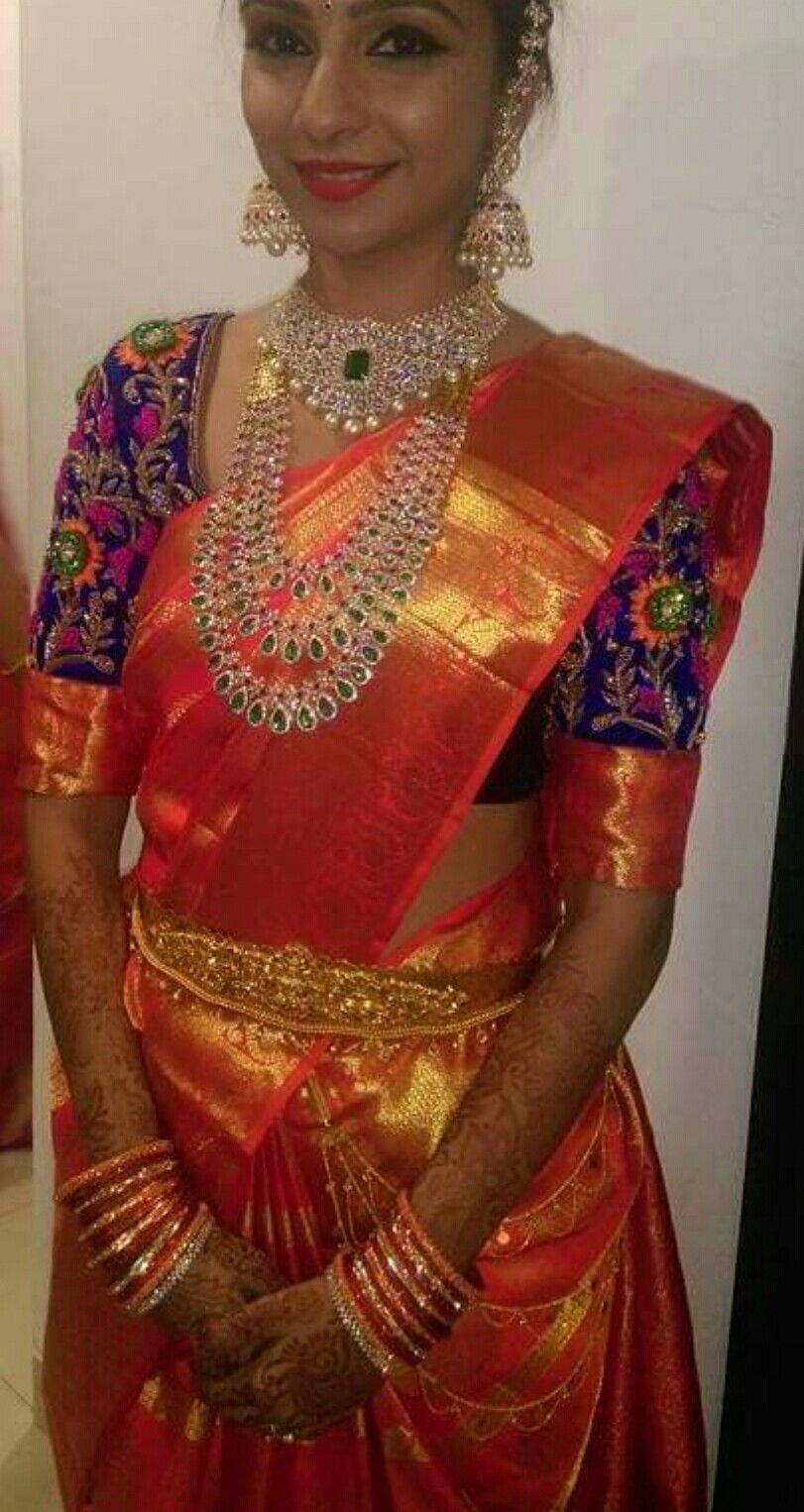 f2b52a12a343dd Glamorous South Indian Bride in a Vibrant Orange Kanjivaram Silk Saree