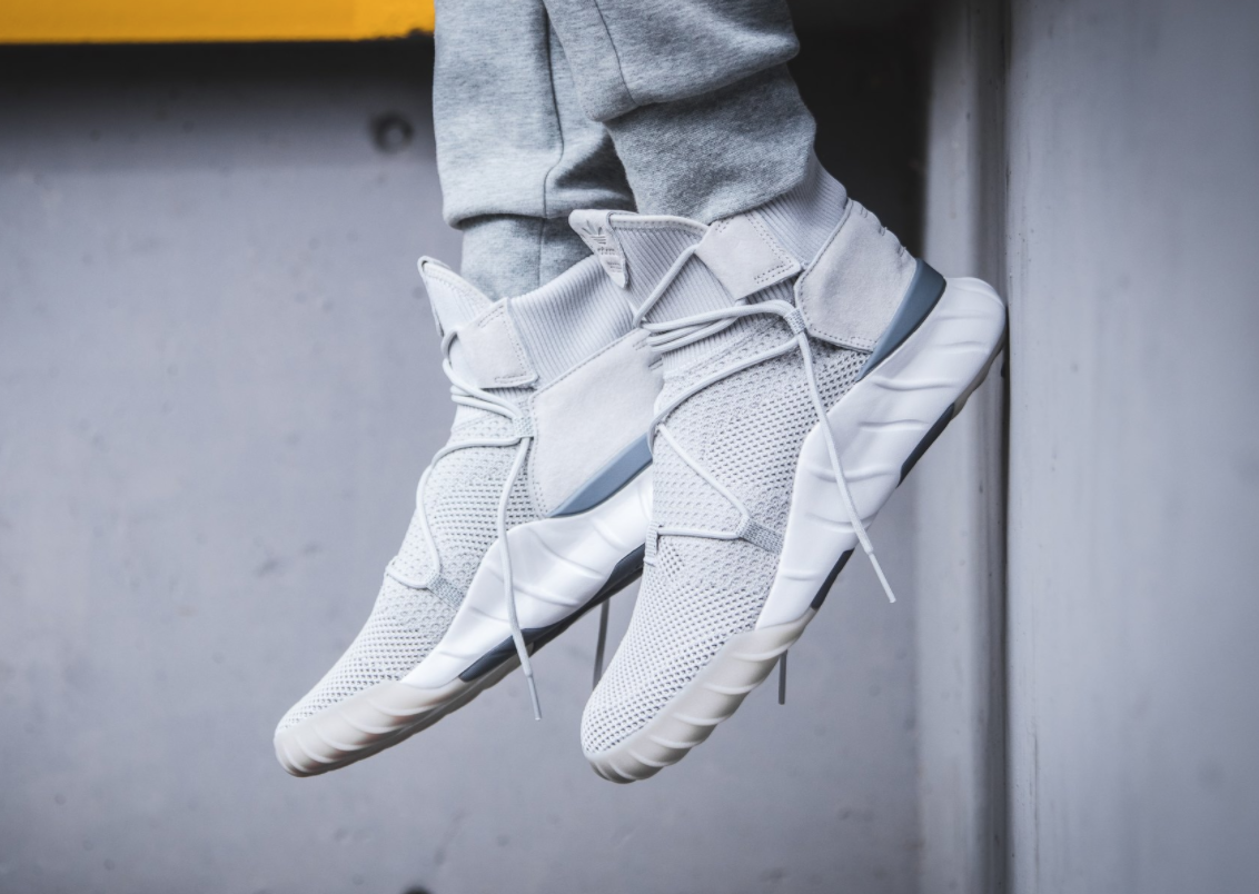 6c90732ab3e9 The adidas Tubular X 2.0 Primeknit Grey White edition is featured in a  lifestyle look and
