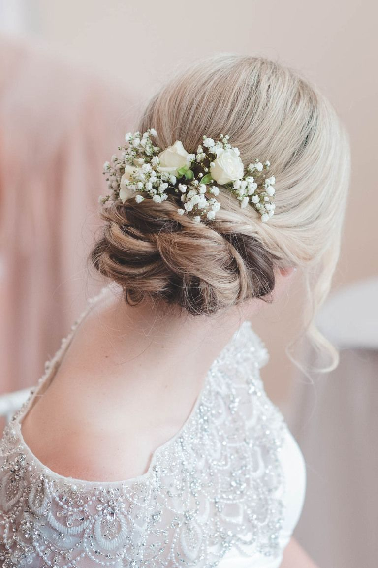 delicate white wedding flowers as wedding hair decorations