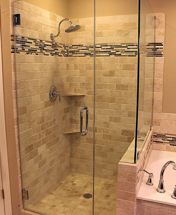 Shower Walls: Ivory Tumbled Travertine 3 X 6 • Shower Floor: Ivory Tumbled Mosaic 2 X 2 • Accent