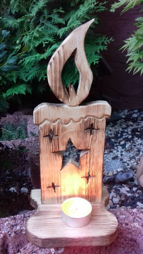 Photo of Christmas decoration, wooden candles, tea light holder, nature gift