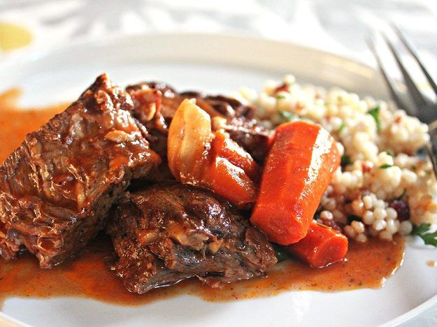 It's important to build the flavors for this slow-cooked, Moroccan-inspired beef pot roast: we use a tomato braising liquid that's spiked with a lemony mint puree and ras-el-hanout, a Moroccan spice mixture. It's served with tart, dried cherry-specked Israeli couscous that's brightened with a touch of lemon zest and fresh parsley.
