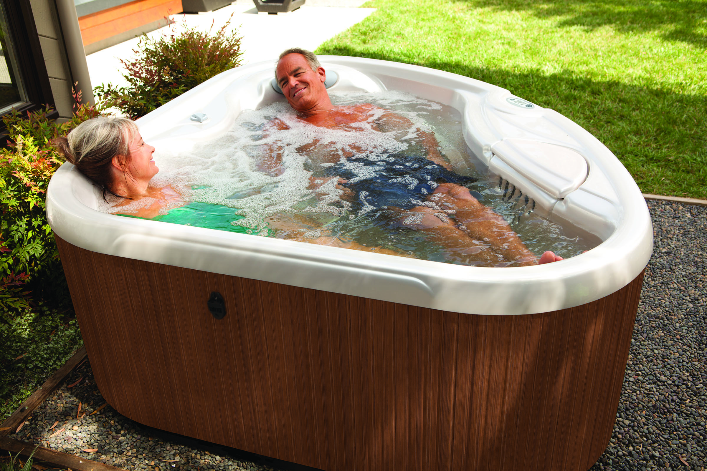 Hot Spot Value Hot Tubs Reviews And Specs Hot Spring Spas Hot Tub Reviews Small Hot Tub Hot Tub Landscaping