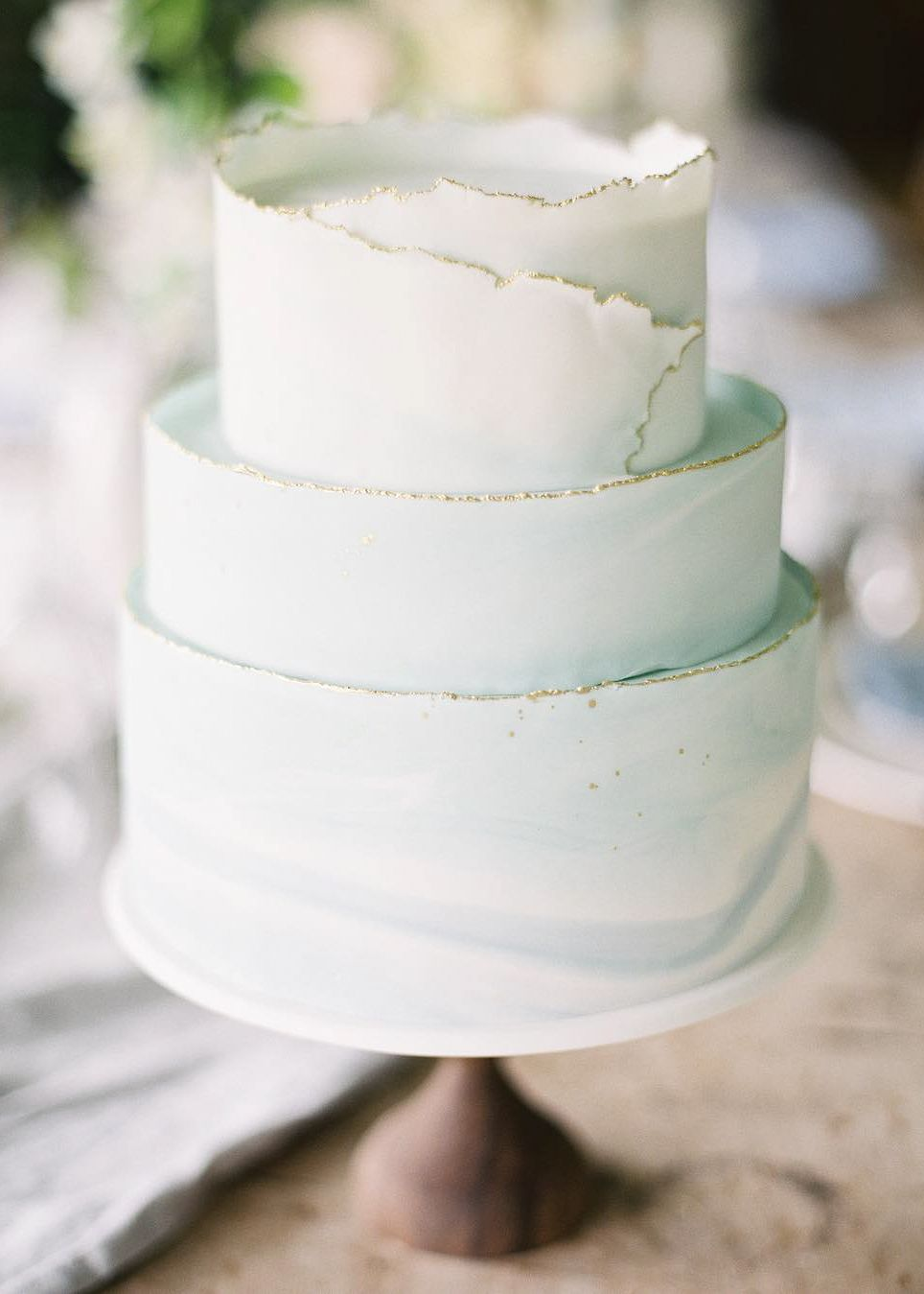 A delicate, minty-blue cake with a unique touch on the top ...