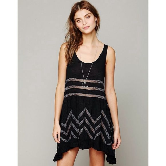 Free People Black Voile & Lace Trapeze Slip Dress Basically new. Only worn a couple times. Sheer dotted slip dress with lace inset throughout. Ruffled hem. Retails for $90. Please comment with any questions! Cheaper on Merc! Free People Dresses Mini