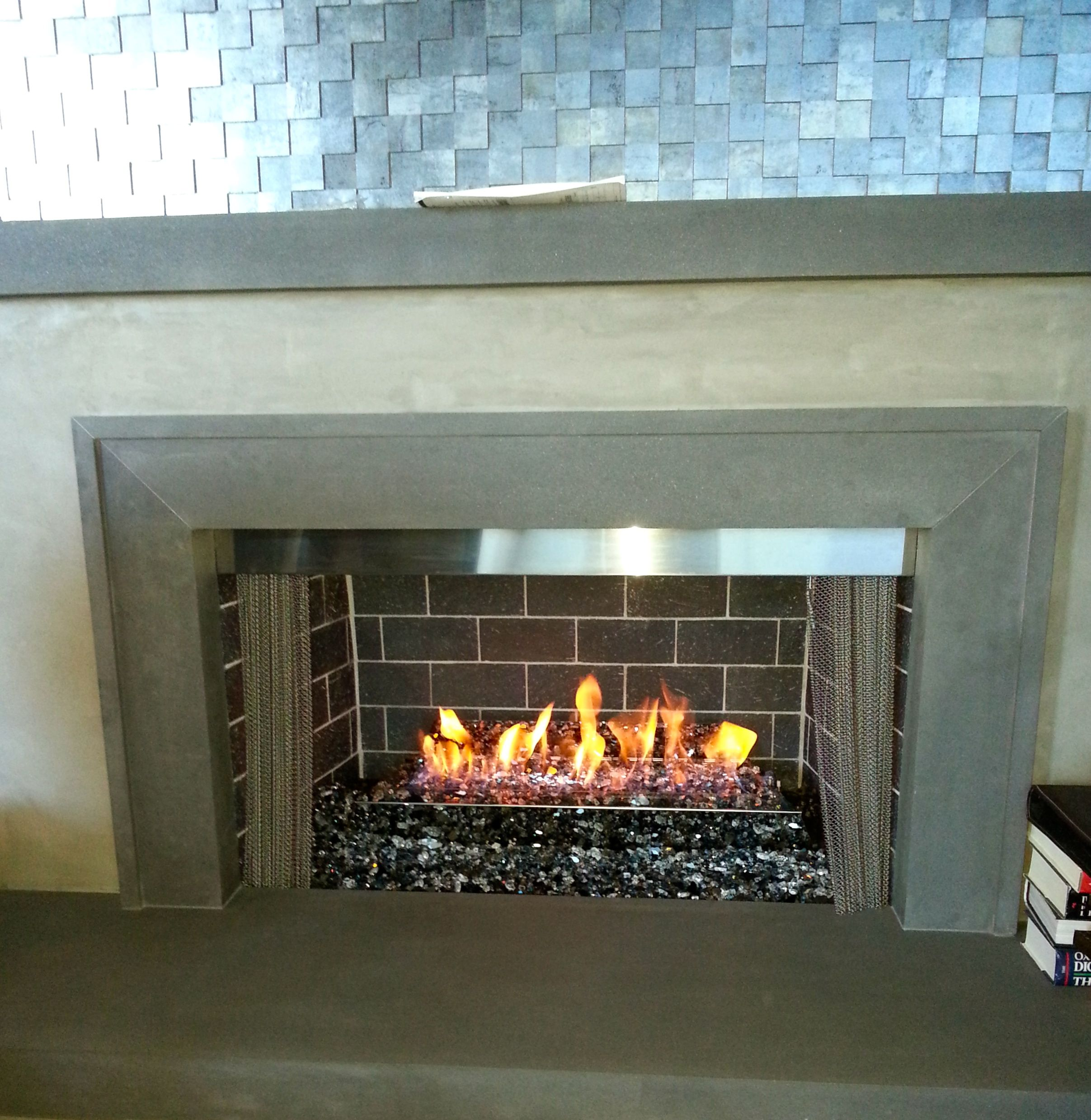 This Contemporary Burner With Stainless Steel Mesh Pull Screens Was