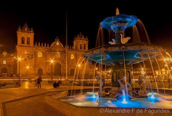 The cathedral and the amazing fountain at night in Plaza de Armas, Cusco, Peru.