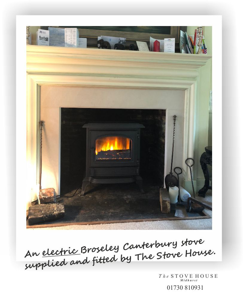 I Love How This Broseley Canterbury Cast Iron Electric Stove With A Clear Door Looks In Our Clients Stone Fireplace Surround