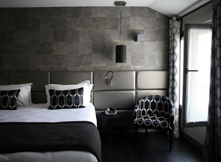 Bedrooms Exquisite Stone Wall Bedroom Design With Grey Leather Headboard And Black White Patterned Single Sofa Also Black Wood Flooring Exquisite Grey