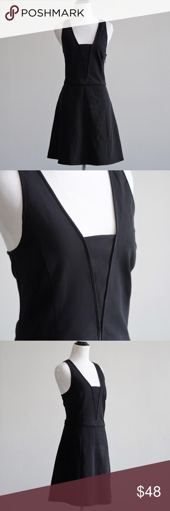 Theory Dress Black 12 Theory Dress •size 12 •black •criss cross straps in the back •zip closure on back •EUC Theory Dresses Midi #blacksleevelessdress