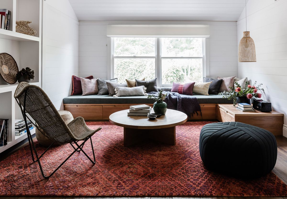 Rich tones ground a small living room in this earthy modern house tour coco kelley