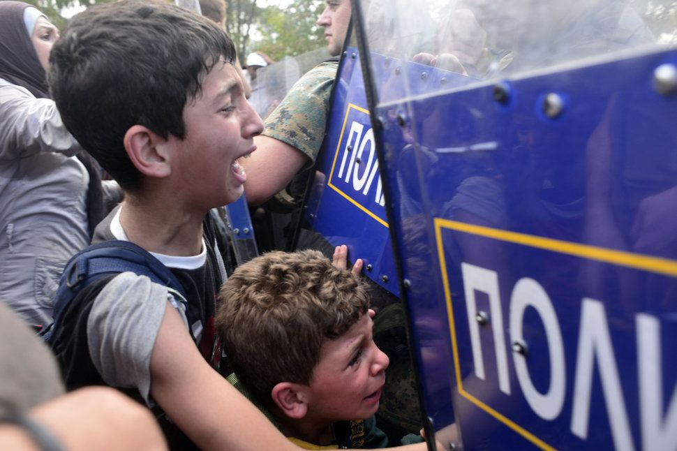 Macedonian police block migrants  at the Macedonian-Greek border 2015.
