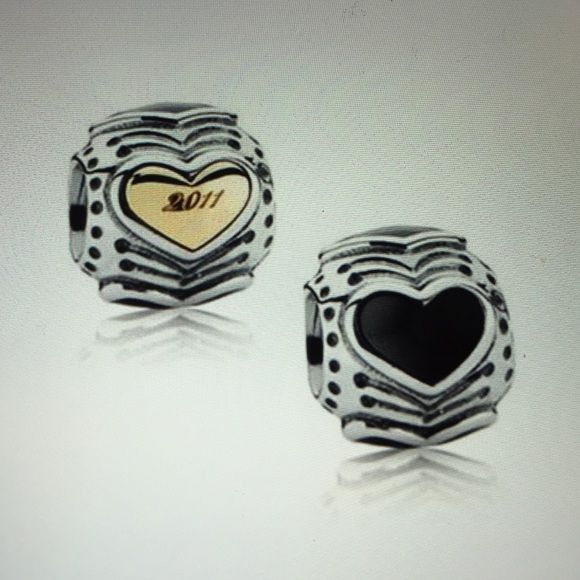 2011 Pandora Charm 2011 Pandora Charm. Black Heart on one side, gold heart on other side with 2011 engraved! Retired Charm! No box! Pandora Jewelry