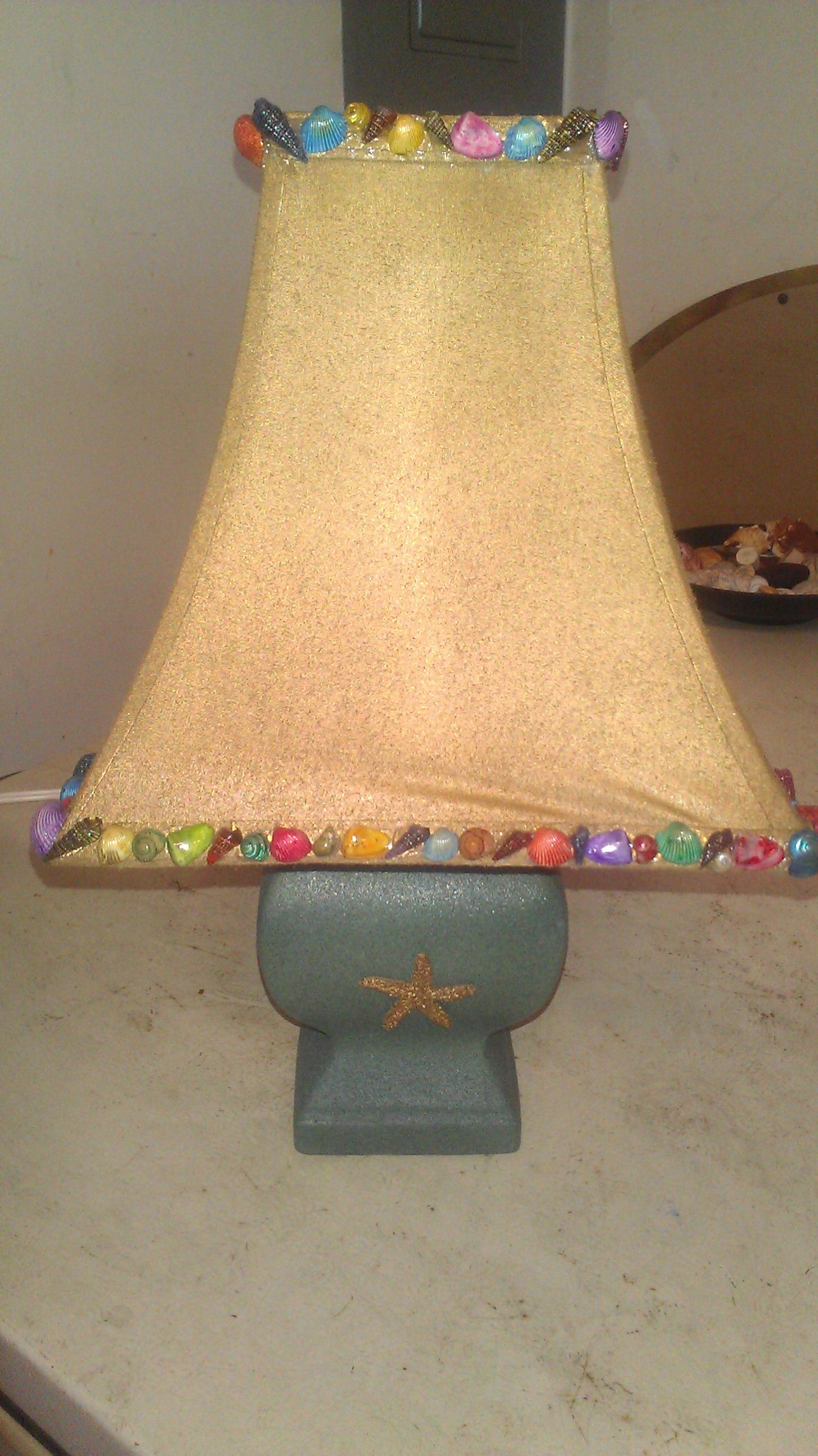 This is a lamp I decorated for my daughter's beach themed