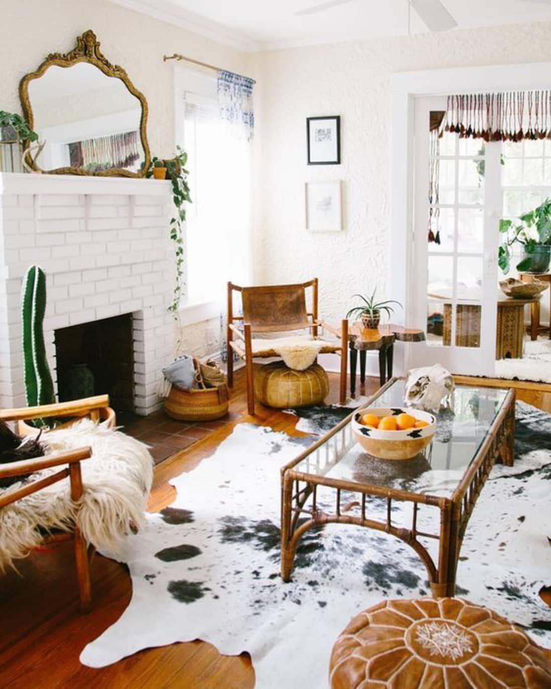 Cowhide Rugs 9 Rooms That Ll Turn Any Skeptic Into A Believer Rugs In Living Room Cowhide Rug Living Room Living Room White