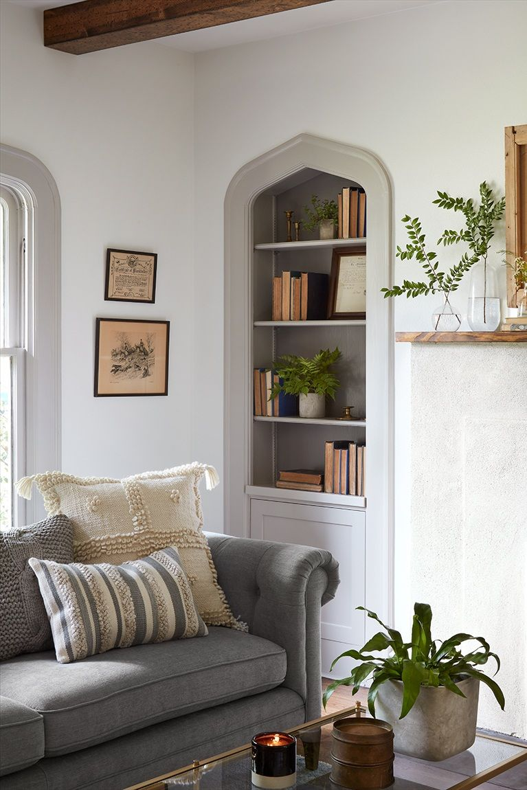 Image result for Scrivano on Fixer Upper. The living room in this 1927 tudor style home has gothic arches and light grey painted trim. #fixerupper #livingroom #scrivano #greytrim