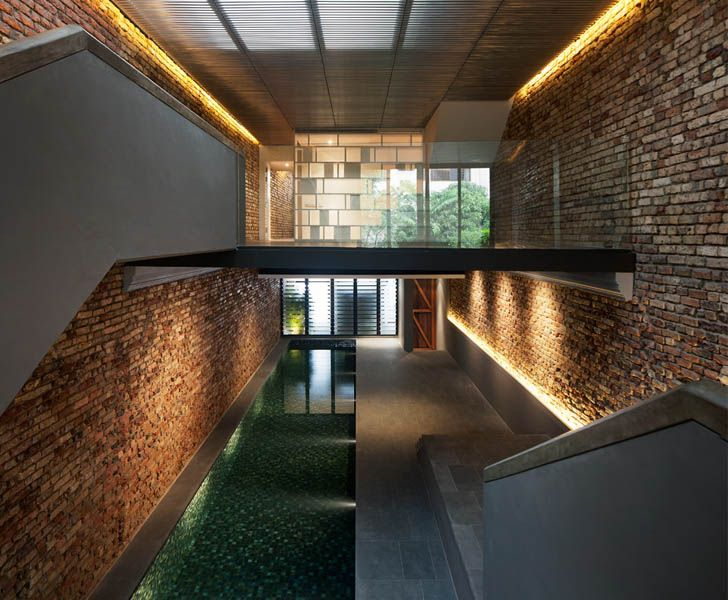 Kd architects transforms old singapore shophouse into a cozy modern home with a pool inside