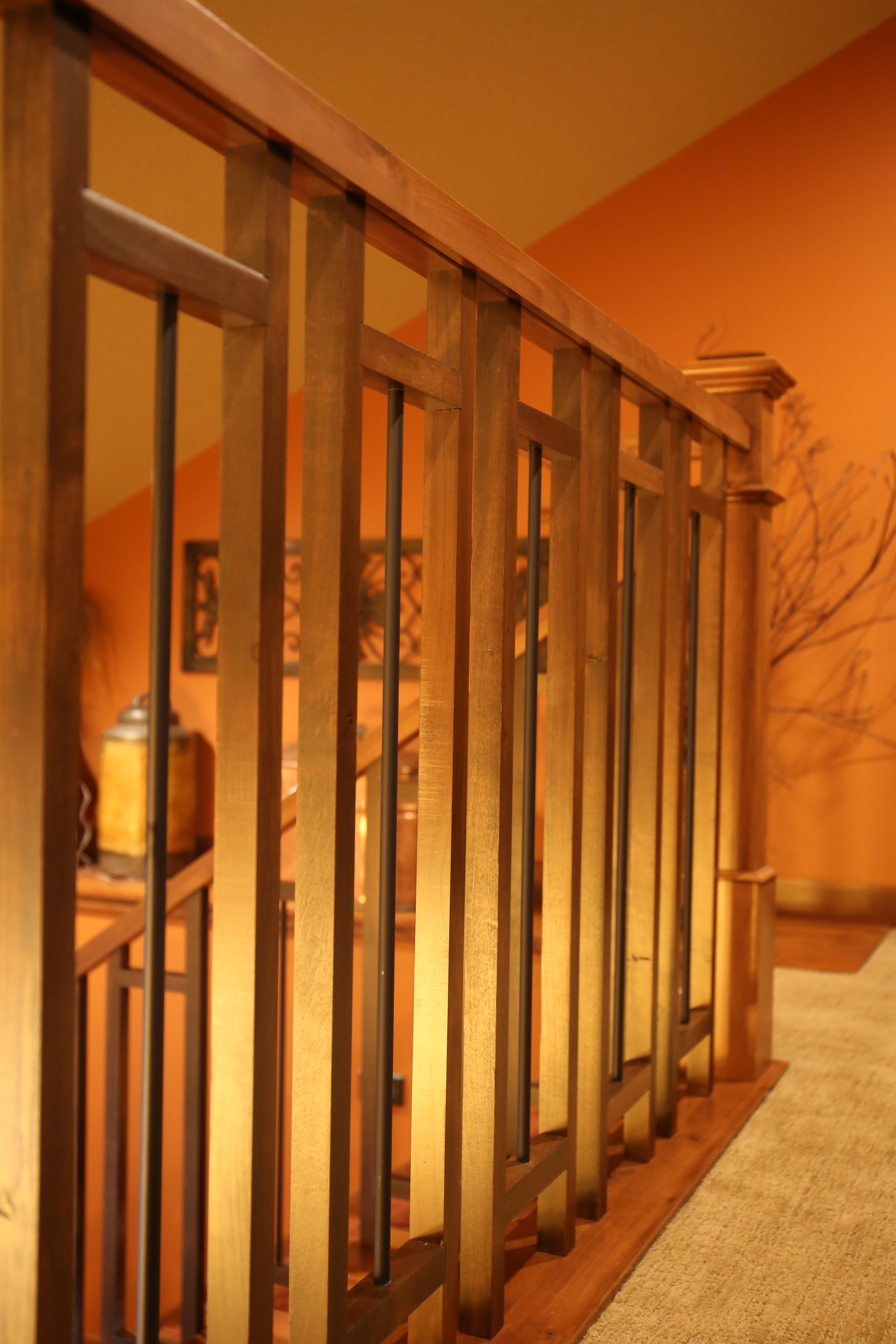 Best Stair Systems Alder Baluster With Wrought Iron Detail 400 x 300