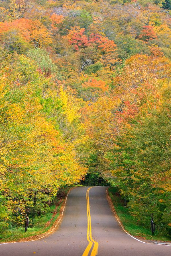 Smuggler's Notch, a section of Vermont Route 108, is a tight mountain road lined with steep cliffs and caves