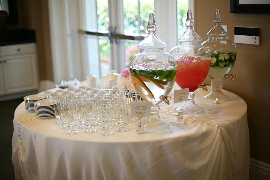 I love the presentation of this beverage table! Apothecary jar beverage dispensers.  Credit: The Special Day