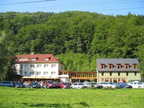 Hotel Skalní Mlýn Blansko Situated in the heart of the Moravian Karst Nature Reserve next to a former water mill, the Hotel Skalní Mlyn offers you en-suite rooms, regional cuisine and a large summer terrace.