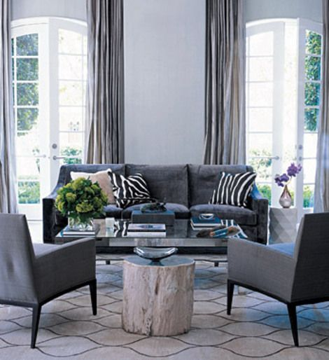 Blue Gray Living Room dovetail gray - elle decor. graphic rug, gray sofa, black & white