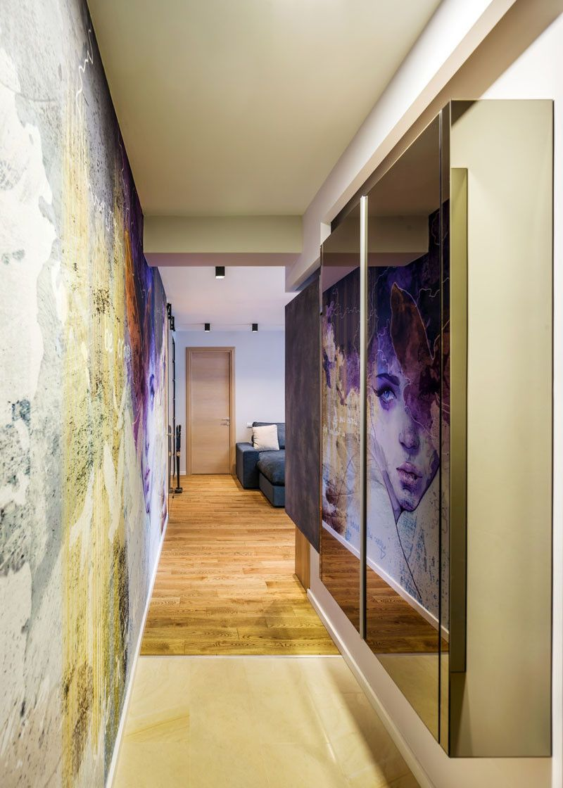 A Large Wall Mural Dominates This Young Couples Apartment