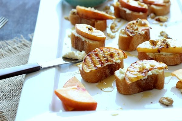 Grilled Peach Crostini with Goat Cheese, Mascarpone & Honey! http://www.yummly.com/blog/2013/08/grilled-peach-crostini-with-goat-cheese-mascarpone-honey/
