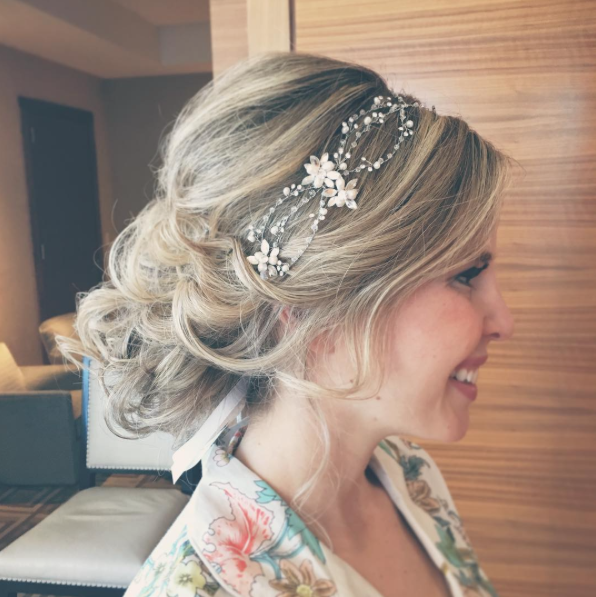 Low Wedding Updo With Curls And Embellished Bridal Headband We