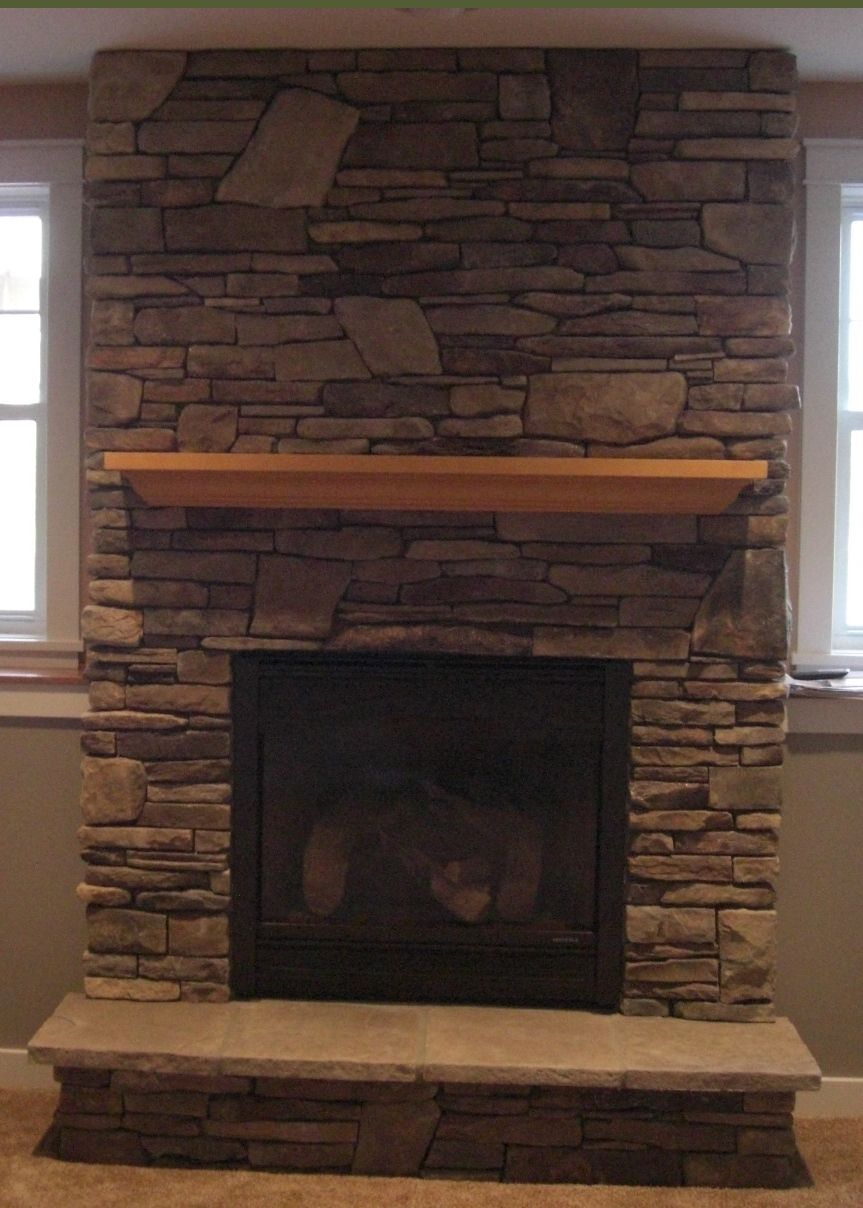 Gas fireplace with cultured stone house decor for Faux marble fireplace mantels