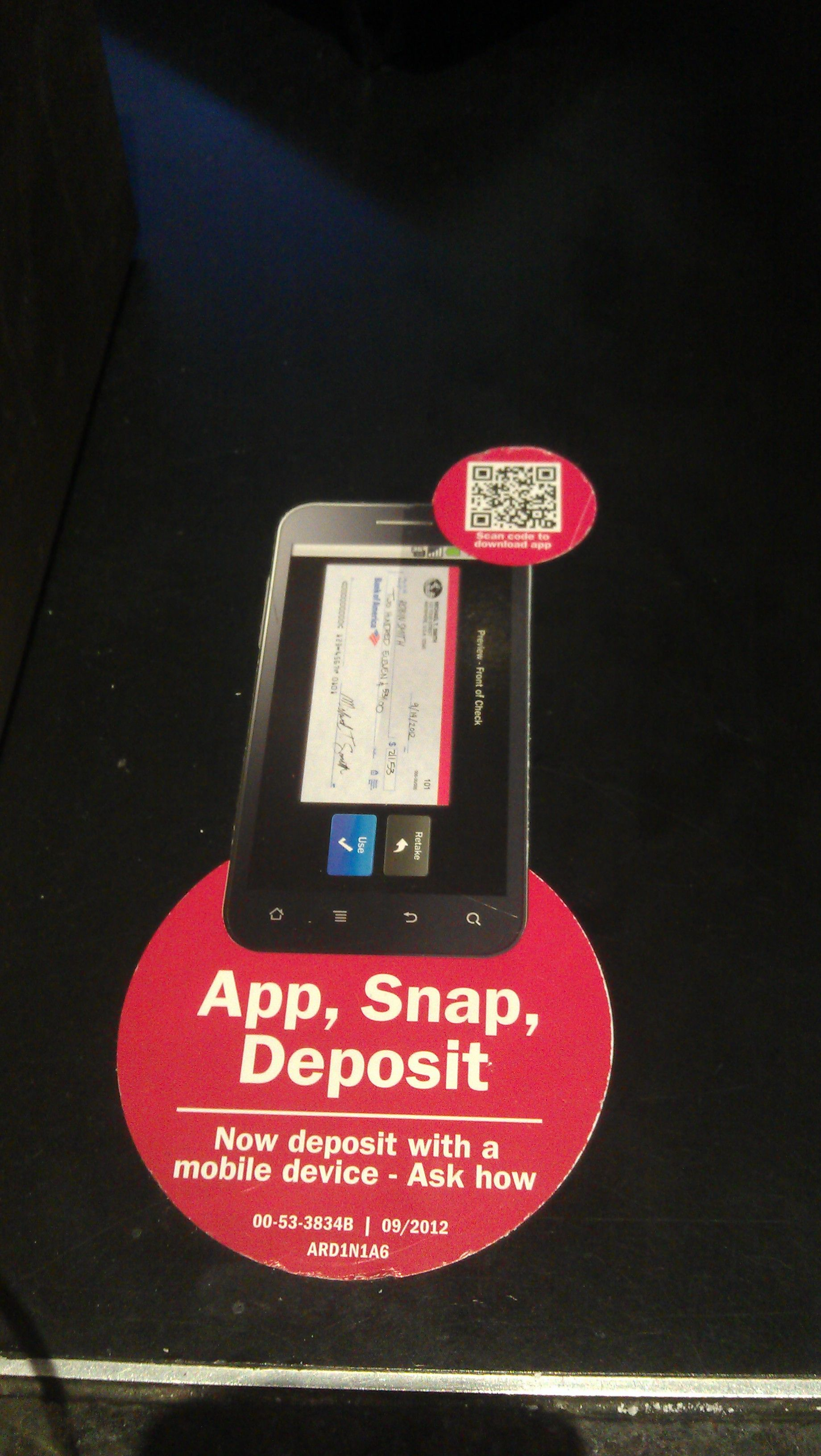 A QR code is used to encourage download of a banking