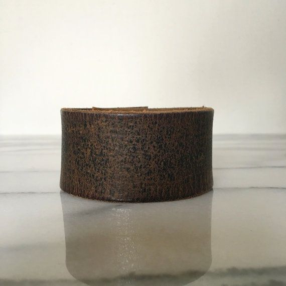 Handstamped leather cuffs at Arrows&ArtCo on etsy
