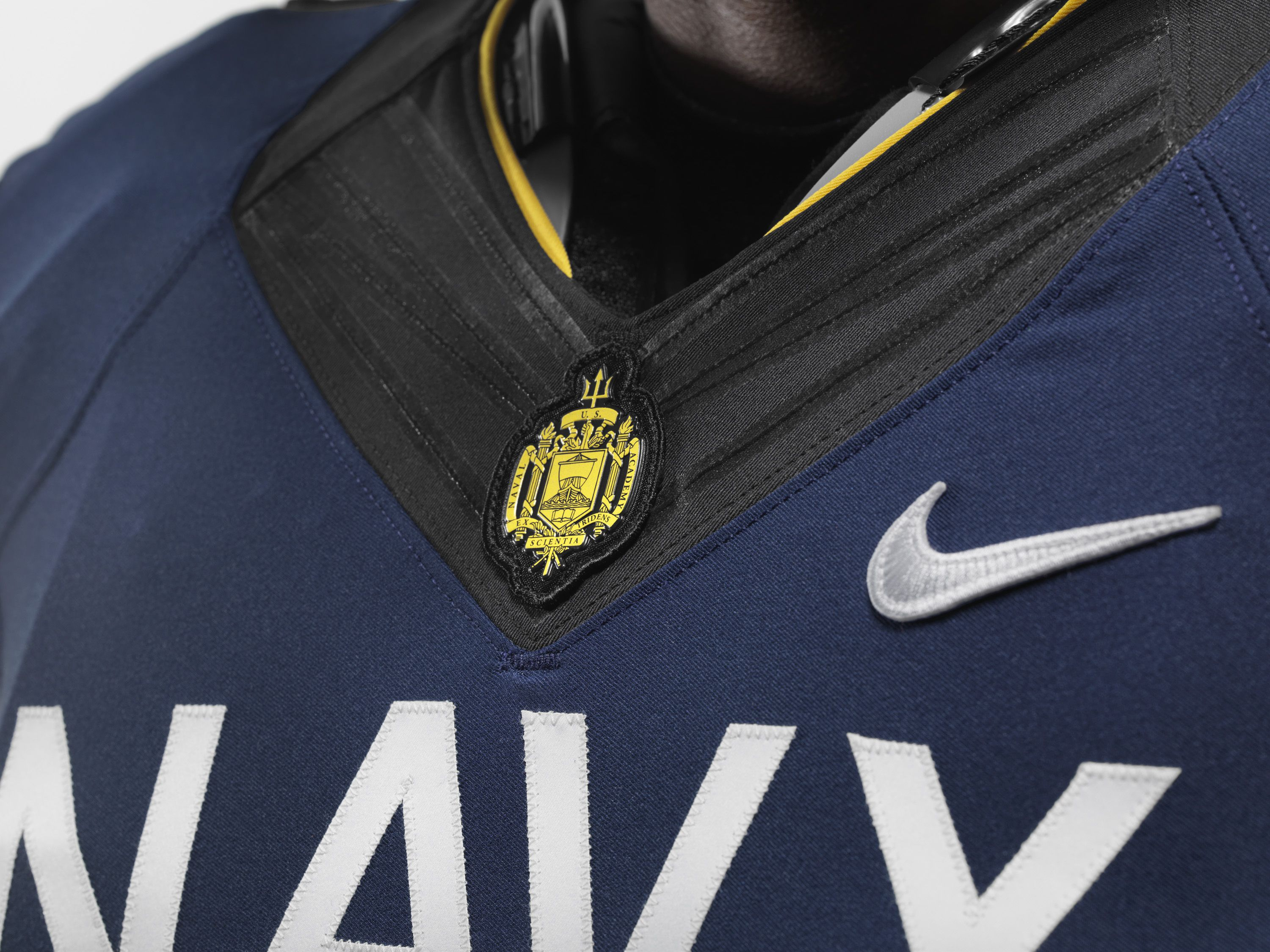the naval academy logo and nike symbol on navy s uniform for the