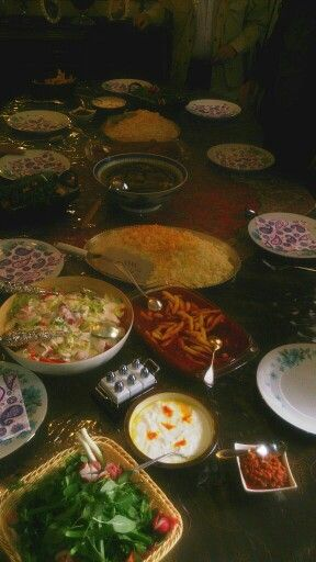 Iranian, traditional food  Including,  rice, special sauce (gheymeh), aash and salad.