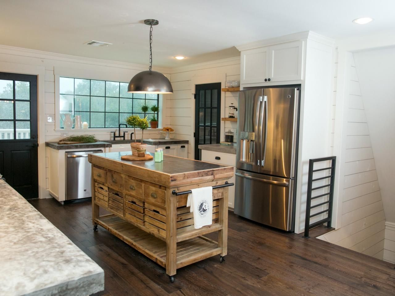 Fixer upper farm kitchens - The Kitchen Located On The Second Floor Effectively Marries Contelmporary Elements Like Stainless Appliances And Black Metal Railing With More Rustic And