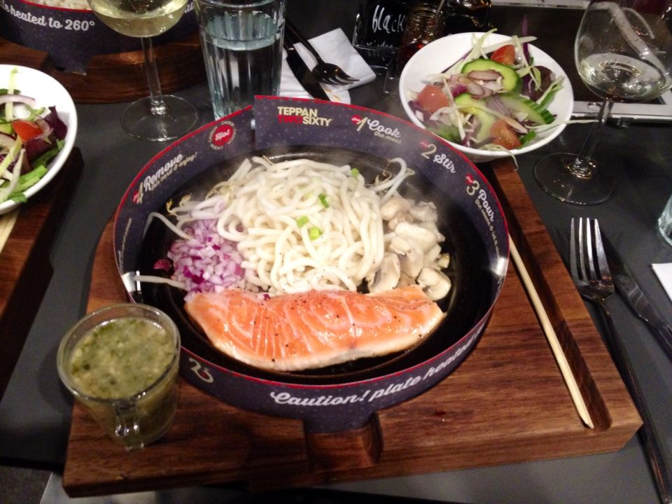 Salmon with udon noodles, red onions, mushrooms, salad and garlic & coriander sauce at Teppan 260, Leeds