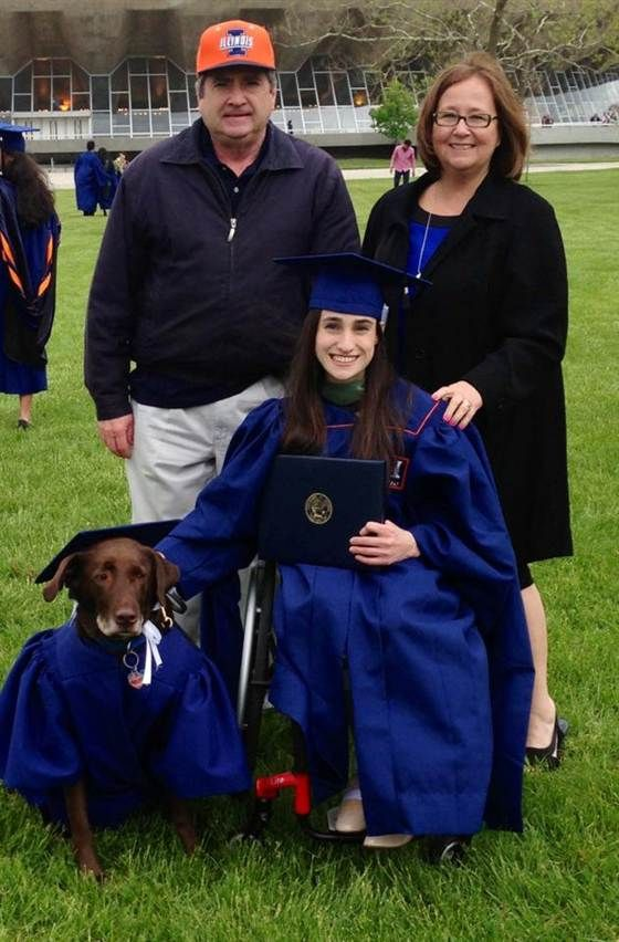 Grad Accepts Diploma With Cap And Gown Clad Service Dog Animals