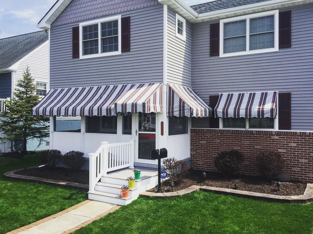A Rigid Door Hood With Softer Window And Porch Awnings For The Perfect Outdoorshade With Sunbrella Entrance Awnings Outdoor Shade Porch Awning