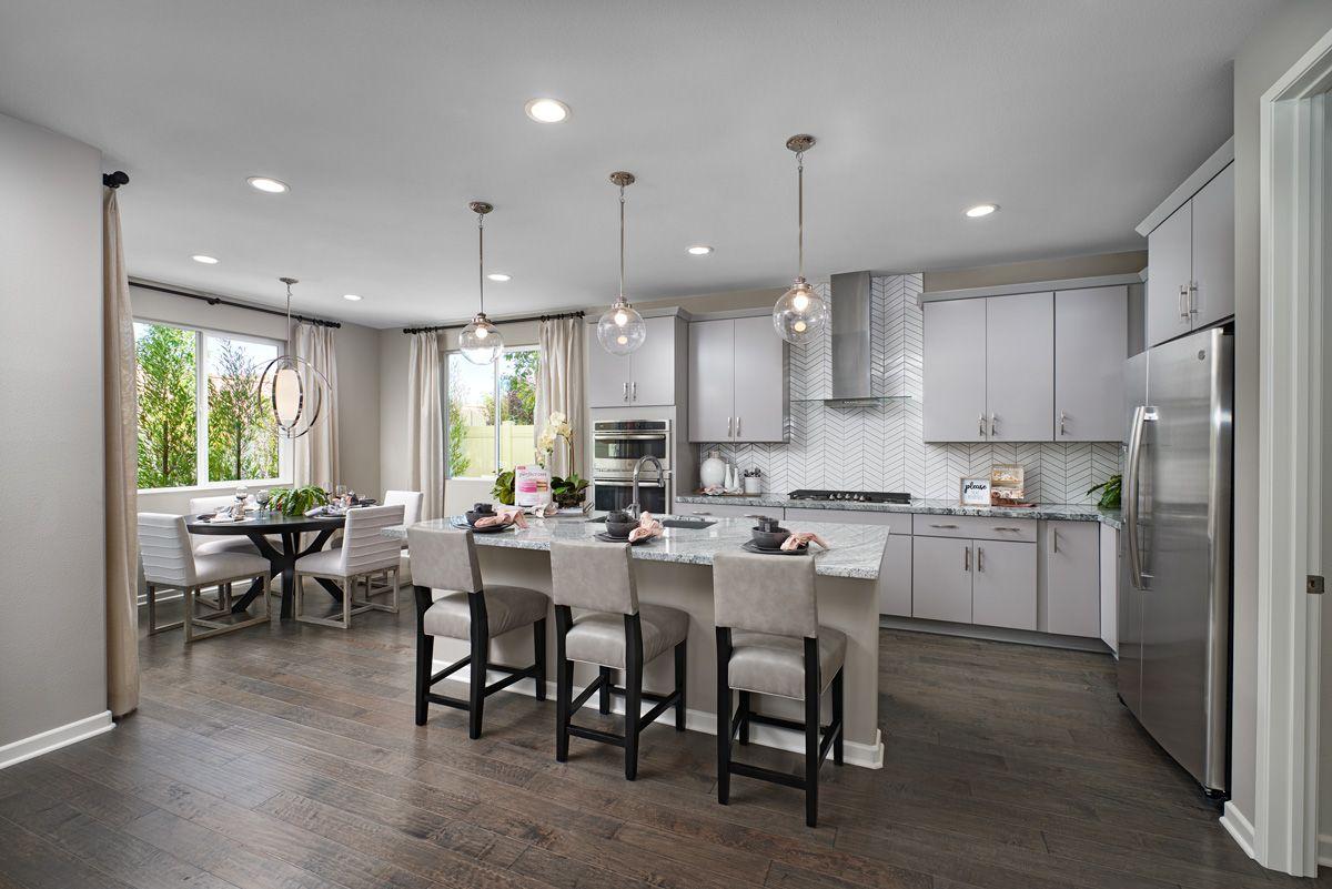 Beautiful backsplash + hood Teagan model home kitchen