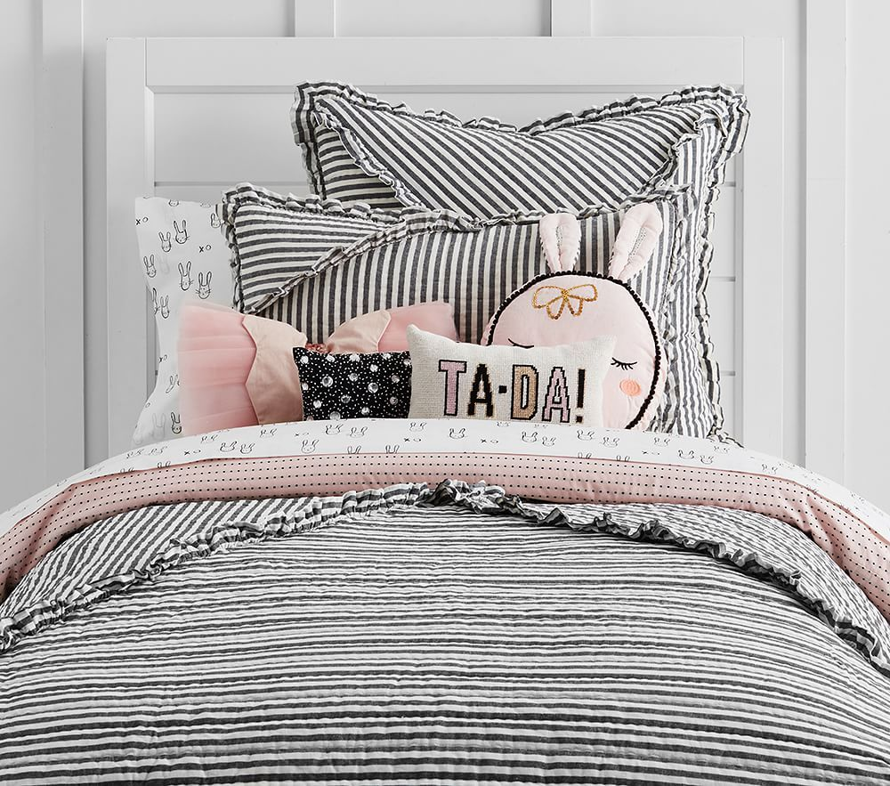 Whimsical stripes decorate our Emily & Meritt Ruffle Stripe Quilted Bedding  for a bold and playful