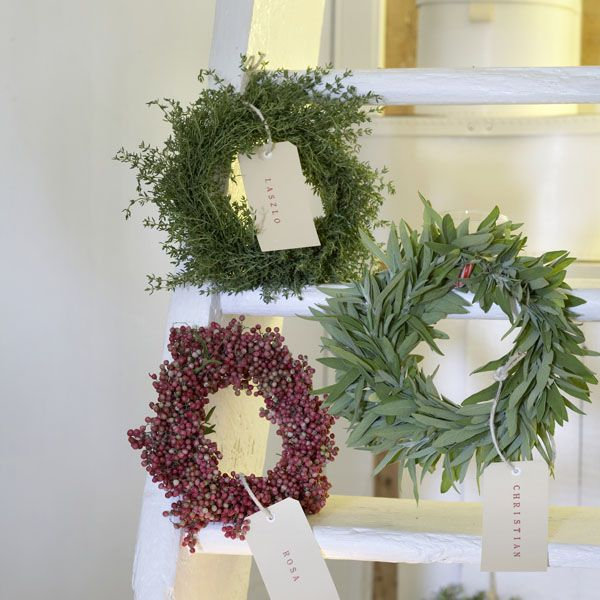 Small wreaths made out of rosemary, sage, thyme and red pepper.